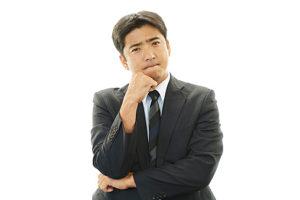 Dissatisfied Asian businessman